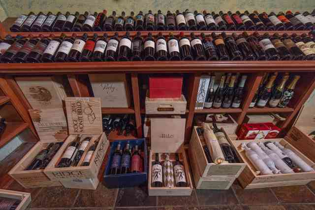 wine bottles in boxes and on shelf
