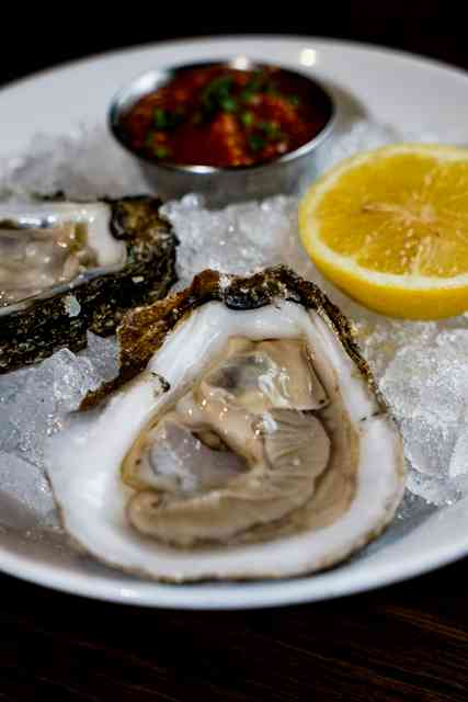 raw oyster in serving dish