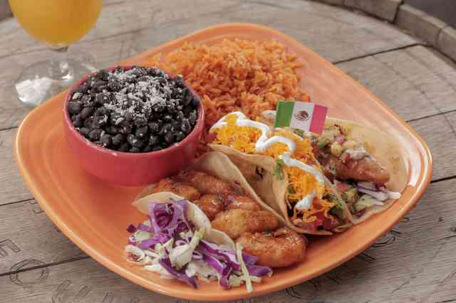 Tres Taco Especial! Our isalnd shrimp taco, tinga taco and tecate fish taco served with rice and black beans.