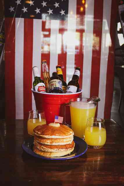 Brunch special of pancakes, OJ and beer