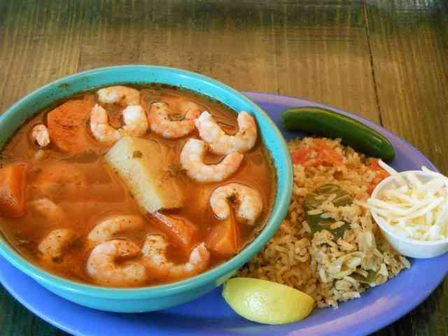 seafood soup with a side of rice