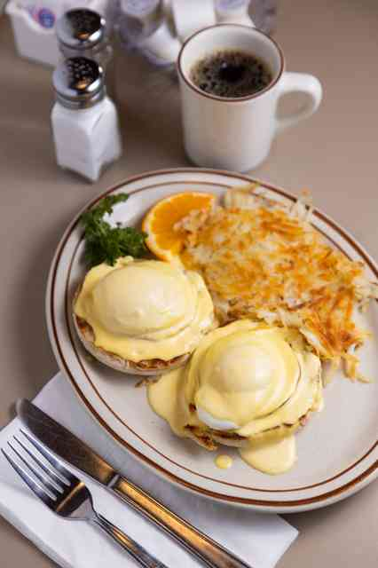 eggs benedict and cup of coffee