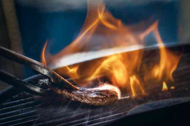 Flame rising out of a grill