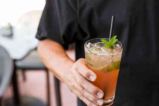 man holding pink moment cocktail