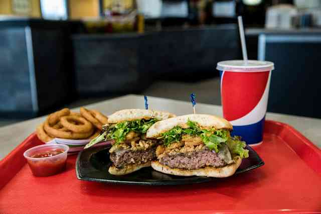 burger with pepsi and onion rings