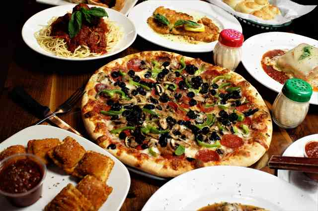 Variety of dishes at Milanias NY Pizza