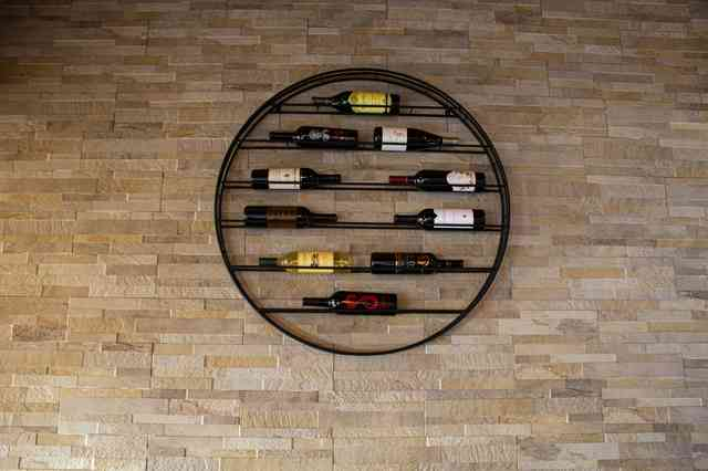 Circular wine wrack mounted on wall