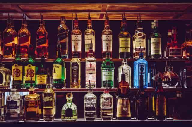 Assorted liquor bottles at bar