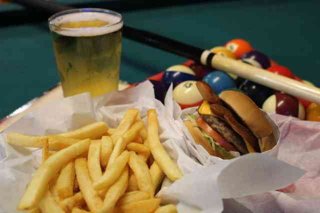 burger and fries on the pool table