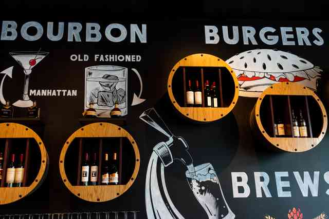 bourbon, burgers, brews sign