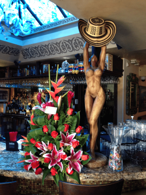 statue and flowers on the bar