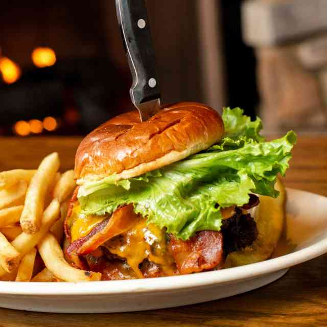 Cheeseburger with lettuce, bacon, and a side of fries