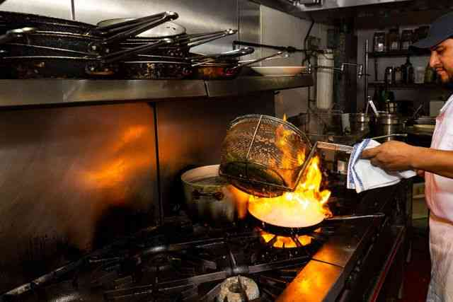 Chef cooking over open flame
