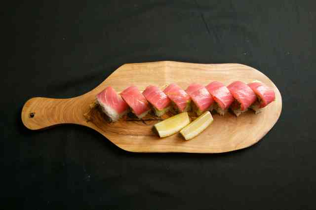 sushi on a paddle
