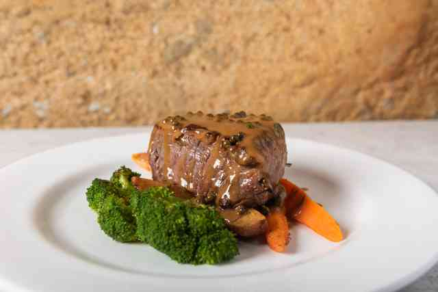 veal dish with carrots and broccoli