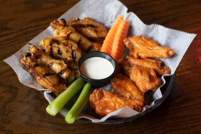 Jumbo pub wings with celery, carrots and dip