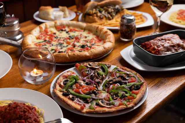 multiple pizza dishes