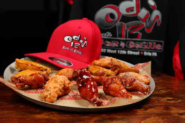 wings on a plate with odis 12 merch