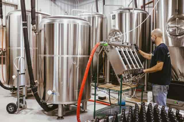 Bryan bottling barrel-aged beer