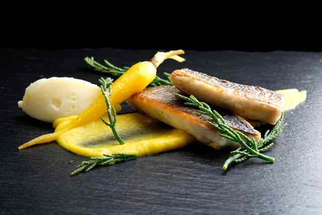 Pan-roasted seabass on yellow carrot puree