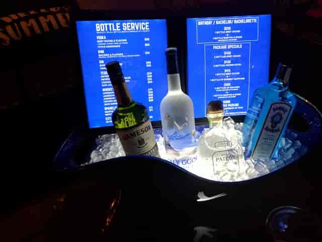 bottles of liquor arranged on a bar