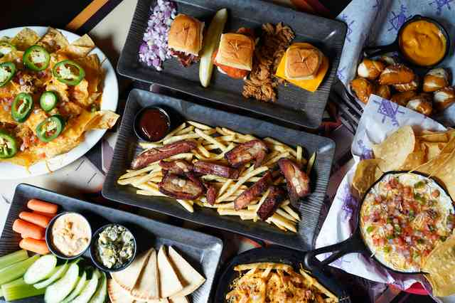 overhead shot of several plates of food