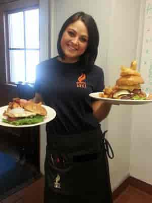 waitress with Mystic Grill food