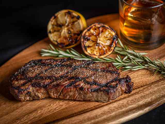 NY Strip Steak and a glass of Whiskey