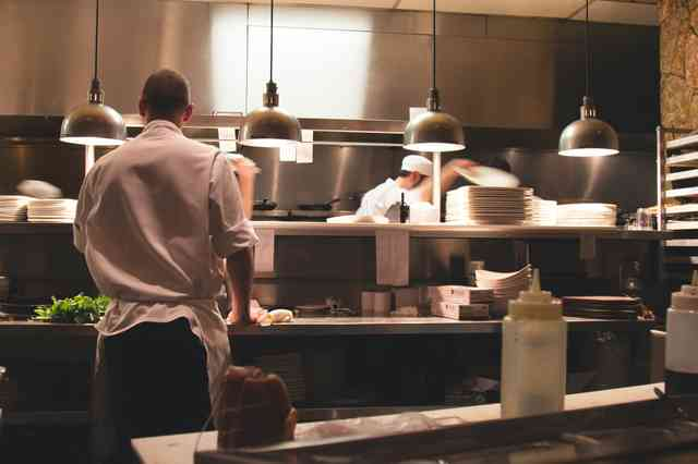 Staff working in a restaurant kitchen