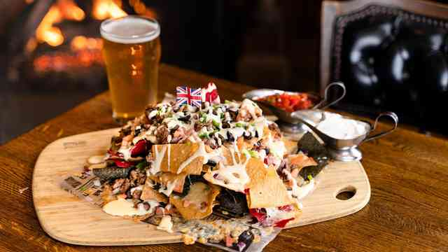 Nachos with toppings pint beer