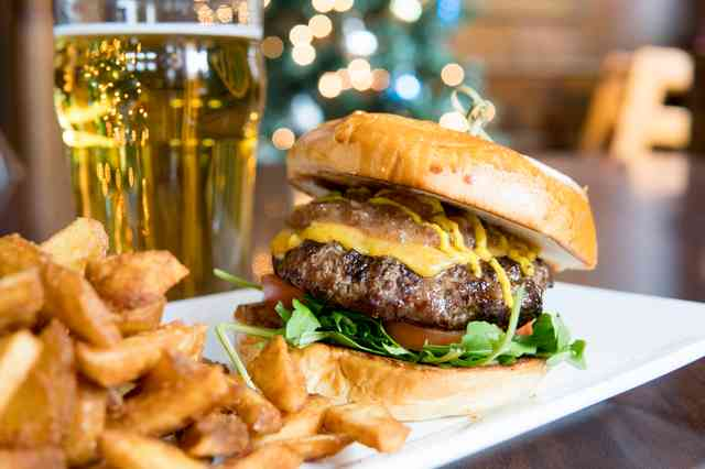 Burger with fries and a glass of beer