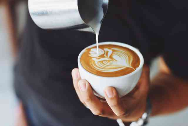 pouring a latte