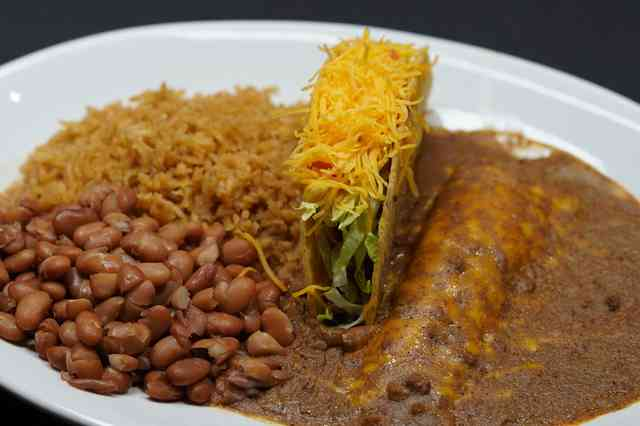 taco beans rice and enchilada