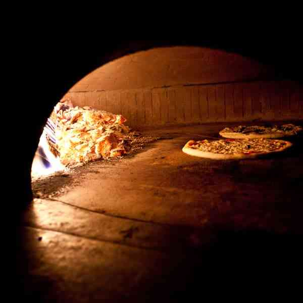 wood fired oven with pizza