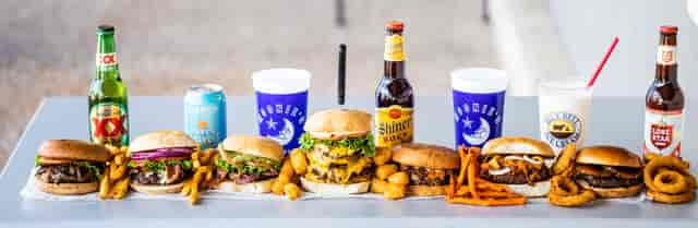 Nine different moonie's burgers with fries, tots and onion rings