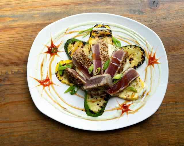 Pan-seared Coriander and Cumin Crusted Ahi Tuna served with Wasabi Mashed Potatoes and Grilled Zucchini & Squash