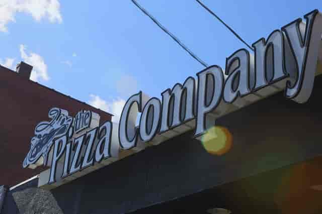 the pizza company sign