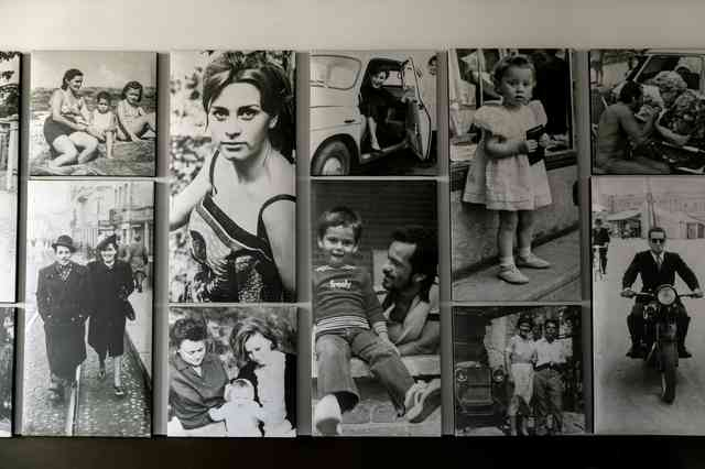 Interior decor of black and white photographs laid out in a masonry style