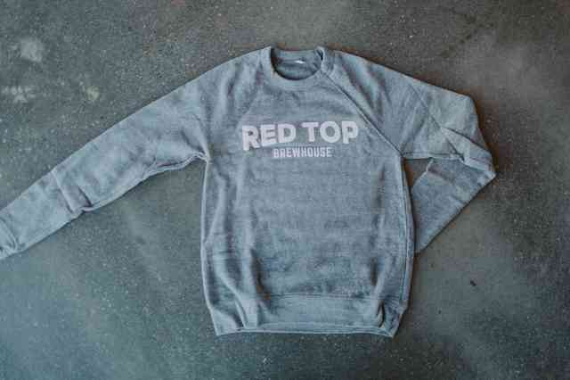 Long sleeve grey sweater with large white wordmark