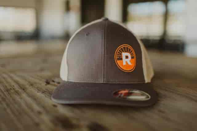 Brown Hat with orange circle R logo on left