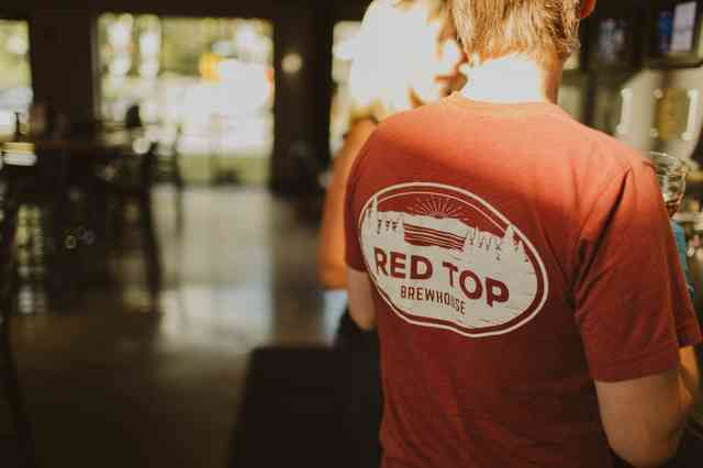 Red Tee shirt with Red Top logo on the back
