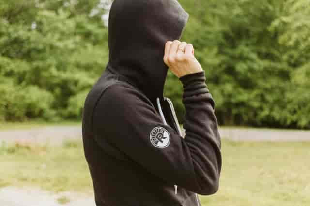 zip up black hoodie with wordmark on left breast and circle R logo on sleeve
