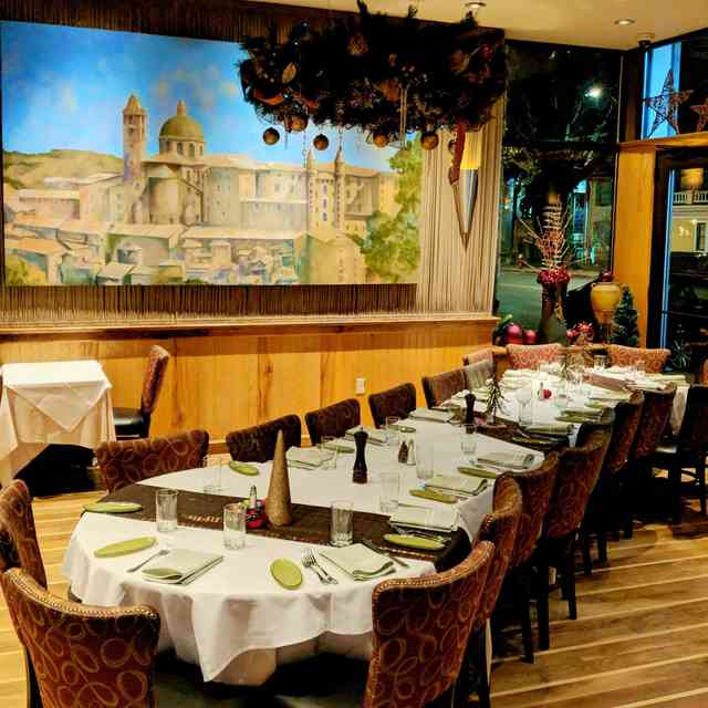 Rustic italian decor with dining set for a large group