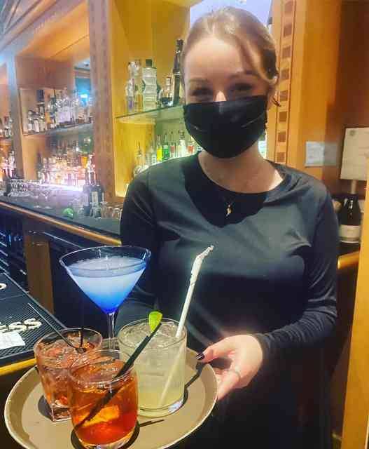 Staff serving a variety of cocktails