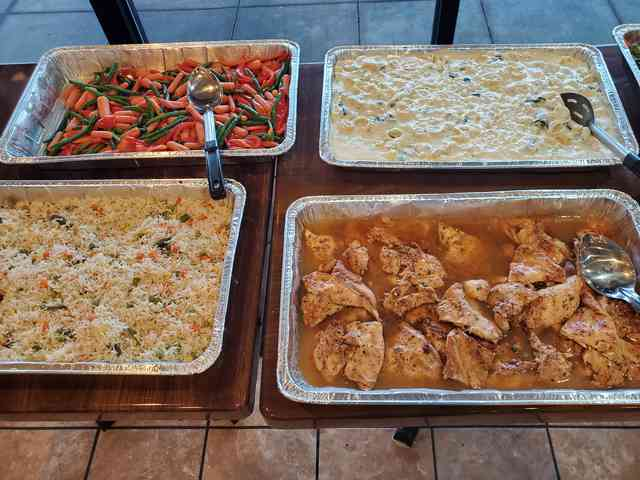 four large catering dishes