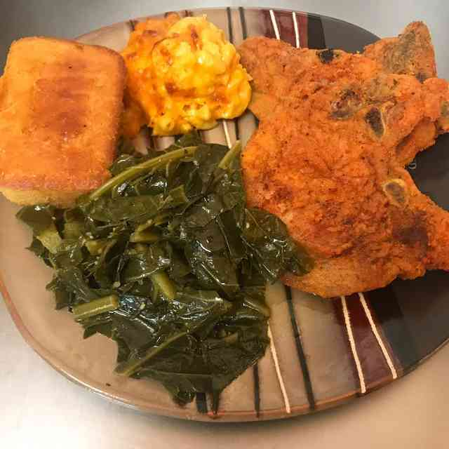 Fried porkchop greens mac and cheese and cornbread