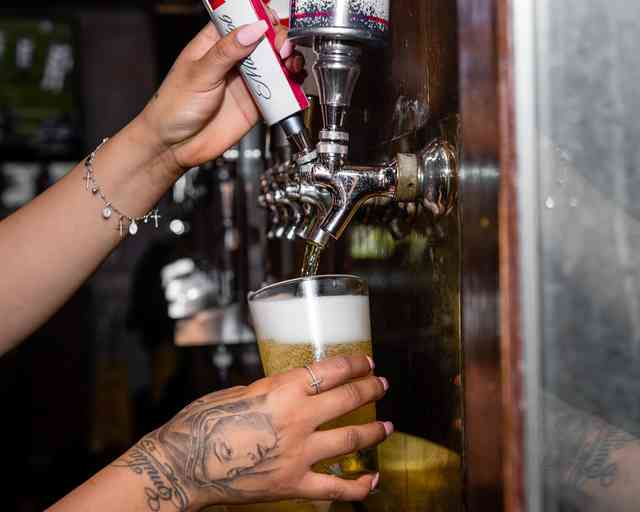 pouring beer from the tap
