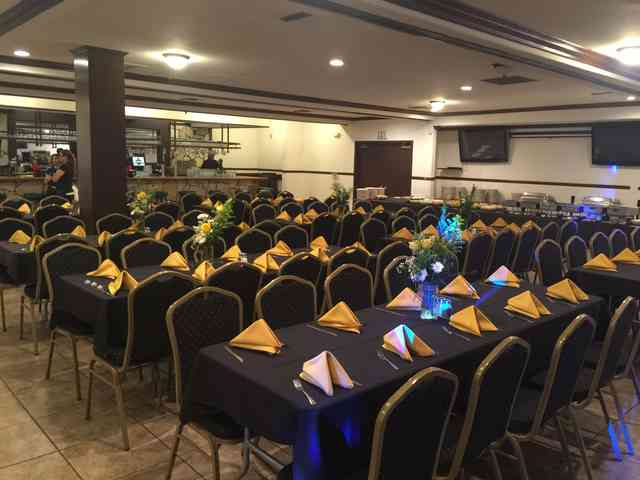 rows of tables with yellow napkins