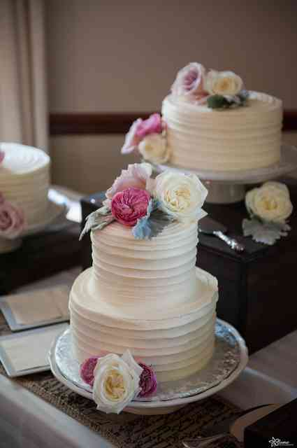 white cake with colorful roses