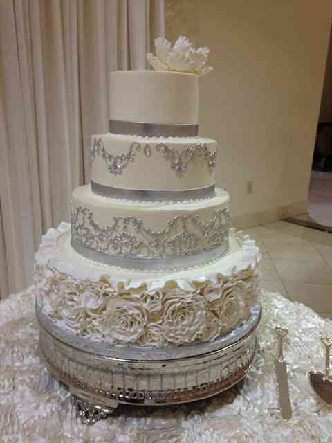 cake with roses and silver decorations